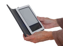 Hands holding an E-Reader. Stock Images