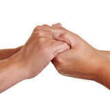 Hands holding each other Stock Photography