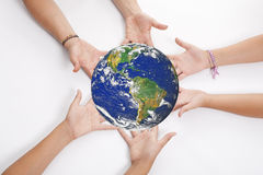 Hands Holding Earth Stock Photo