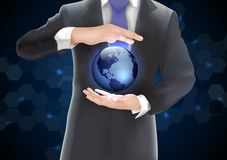 Hands holding earth with blue of background on blue and black Stock Photography