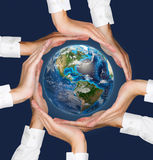 Hands holding earth. Stock Photography