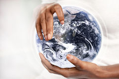 Hands holding earth. Female hands holding planet earth. Earth image by NASA Royalty Free Stock Photos