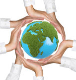 Hands holding earth with grass africa Stock Photos