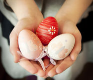Hands Holding Easter Eggs Stock Photo