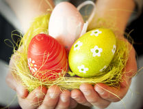 Hands Holding Easter Eggs Royalty Free Stock Photos