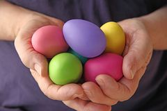 Hands holding Easter eggs Royalty Free Stock Image