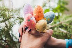 Hands holding Easter eggs on a stick, Stock Image