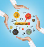 Hands holding education icons. On blue background stock photography