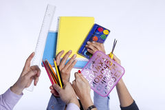 Hands holding education objects Royalty Free Stock Images