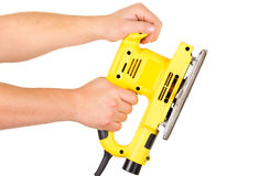 Hands holding an electrical sander Stock Images