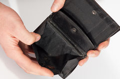 Hands holding an empty black wallet. Isolated on white background. Poverty, crisis Royalty Free Stock Photo