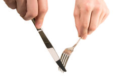 Hands holding empty fork and knife. Mans hands are holding fork and knife isolated on white background, are ready to cut and take next pease of food or any other Stock Photos