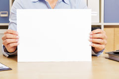 Hands holding empty white sheet of paper Royalty Free Stock Photo