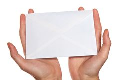 Hands  holding envelope. Isolated over white background Royalty Free Stock Images