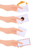Hands holding envelopes Royalty Free Stock Images