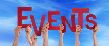 Hands Holding Events in the Sky. Many Hands Holding the Word Evens in the Sky Stock Images