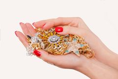 Hands holding expensive gold jewelry Royalty Free Stock Photo