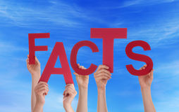 Hands Holding Facts in the Sky Stock Image