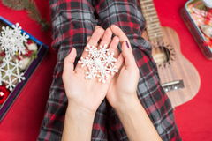 Hands holding a fake snowflake Stock Photography