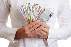 Hands holding fan made of Euro Stock Photography