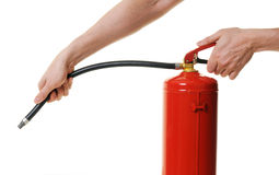 Hands holding fire extinguisher. Over white background Stock Photo