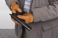 Hands holding a firearm Stock Images
