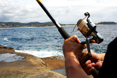 Hands holding fishing rod Stock Images