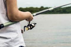Hands holding a fishing rod and twist Stock Photography