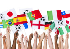 Hands Holding Flag for Soccer Support Royalty Free Stock Photos