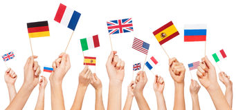 Hands holding flags of USA and EU member-states Stock Images