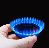 Hands holding a flame gas Stock Photography