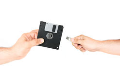 Hands Holding Floppy Disk Versus Flash Memory Stick. Isolated On White Background stock photography