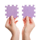 Hands holding foam puzzle pieces Stock Photos