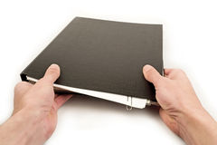 Hands holding folder Stock Photography