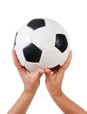 Hands holding football Royalty Free Stock Images