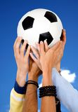 Hands holding a football Royalty Free Stock Images