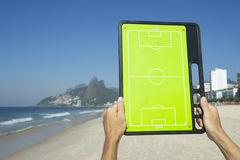Hands Holding Football Tactics Board Rio Beach Brazil Stock Photography