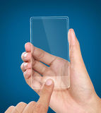 Hands holding futuristic transparent mobile phone Stock Image