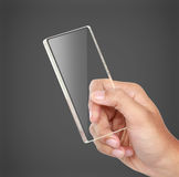 Hands holding futuristic transparent mobile phone Royalty Free Stock Images