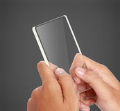 Hands holding futuristic transparent mobile phone Royalty Free Stock Image