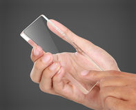 Hands holding futuristic transparent mobile phone Stock Images