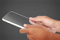 Hands holding futuristic transparent tablet pc Royalty Free Stock Photos