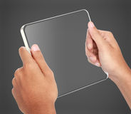Hands holding futuristic transparent tablet pc. Portrait of hands holding futuristic transparent tablet pc Stock Photography