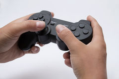Hands holding a gamepad Royalty Free Stock Photos