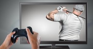 Hands holding gaming controller with golf player on television royalty free stock image