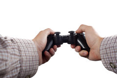 Hands holding gaming controller on white stock photography