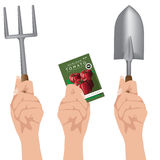Hands holding gardening supplies Royalty Free Stock Photo