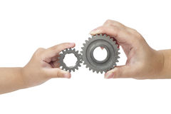 Hands holding gear Stock Photography