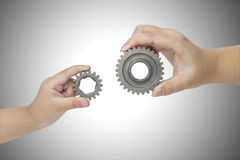 Hands holding gear Stock Image