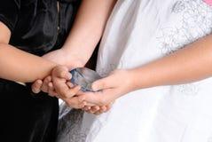Hands Holding Gem Stock Images